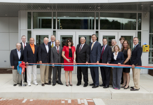 WCCC President Tuesday Stanley (center) cuts the ribbon to dedicate the college's Advanced Technology Center flanked by, from left: Bud Smail (WCCC Educational Foundation); Tim White (RIDC); Rep. Ted Harhai; Daniel Obara (former WCCC president); Charles Anderson (Westmoreland County Commissioner); Carlos Cardoso (Kennametal president and CEO); Larry Larese (chairman, WCCC board of trustees); Ted Kopas (Westmoreland County Commissioner), Chad Amond (Westmoreland County Chamber of Commerce president); Phil McCalister (WCCC Educational Foundation president); Sen. Kim Ward; Max Inks (WCCC alumnus); Kristin Malie (representing Commissioner Tyler Courtney); Congressman Tim Murphy.