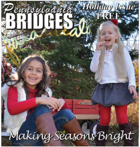 On the cover: Della and Lila Mitchell strike a pose, ready for the season dressed in their colorful and festive winter outfits.