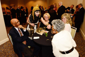 "Cleopatra a la ""A Night at the Museum"" visited with Monongahela Valley Hospital Gala's guests, from left, Richard Wells, Auxiliary President Kay Blair, Auxiliary Past-President Ruth Antonelli  and Dimensions in Performance awardee Sarah Wells (foreground)."