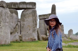 Della Mitchell smiles for the camera in front of historic landmark Stonehenge
