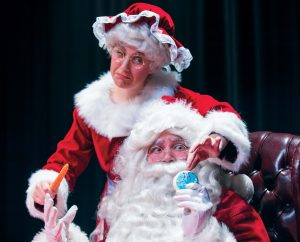 Annabel Lorence as Mrs. Claus and Nick Franczak as Santa struggle between cookies and carrots. The Happy Elf runs December 8, 9 and 10 at 7pm, and December 10 and 11 at 2pm.
